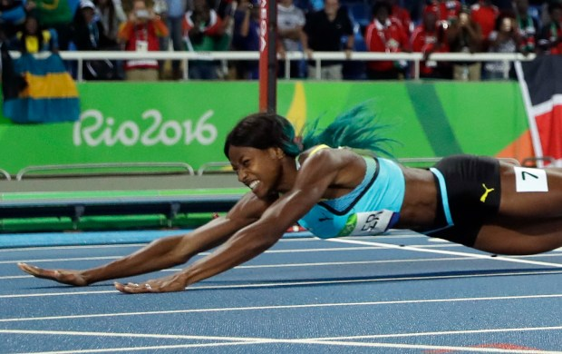 Bahamas' Shaunae Miller falls over the finish line to win gold in the women's 400-meter final during the athletics competitions of the 2016 Summer Olympics at the Olympic stadium in Rio de Janeiro, Brazil, Monday, Aug. 15, 2016. (AP Photo/Matt Slocum)
