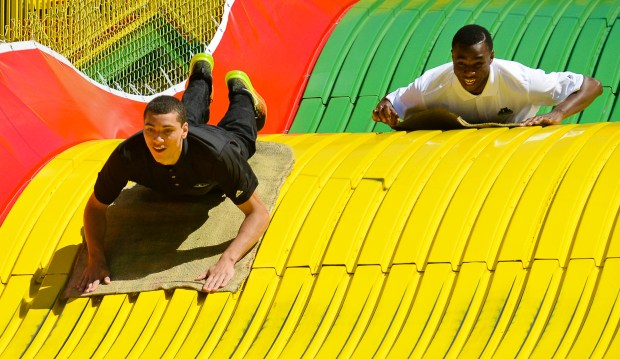 Zach LaVine, left, and Andrew Wiggins ride the Giant Slide after a press conference introducing them to fans at the Minnesota State Fair in Falcon Heights, Minn., on August 26, 2014. (Pioneer Press: Ben Garvin)