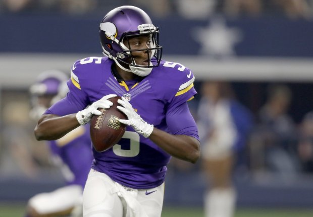 FILE - In this Aug. 29, 2015 file photo, Minnesota Vikings quarterback Teddy Bridgewater (5) rolls out to pass against the Dallas Cowboys during the first half of a preseason NFL football game in Arlington, Texas. (AP Photo/Brandon Wade, File)