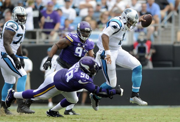 Carolina Panthers' Cam Newton (1) tries to evade the tackle of Minnesota Vikings' Linval Joseph (98) in the first half of an NFL football game in Charlotte, N.C., Sunday, Sept. 25, 2016. (AP Photo/Mike McCarn)