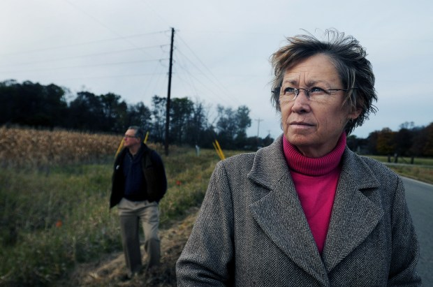 """This is a crime scene. I drive by here every day, but I just can't deal with being here and looking at it. It's a nightmare,"" said Patty Wetterling, right, standing with her husband Jerry along the west side of 16th Avenue SE (then 91st Avenue South), about a quarter mile from their St. Joseph home, where their son Jacob was abducted and kidnapped 20 years ago, in St. Joseph on Sunday, October 18, 2009. (Pioneer Press: Richard Marshall)"