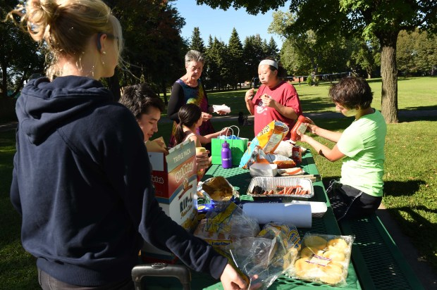 Ross Callahan holds a picnic and cook-out with family and neighbors in Central Village Park, which is adjacent to his St. Paul property, Wednesday, August 31, 2016. Property boundary mix-ups have led to the city building a bike and pedestrian path half of which is on Callahan's property.  (Pioneer Press: Scott Takushi)