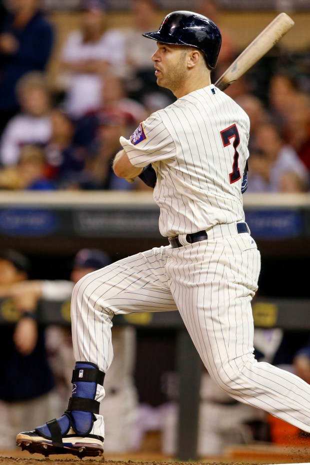 Minnesota Twins' Joe Mauer watches as his RBI-single defeats the Cleveland Indians in the twelfth inning of a baseball game Saturday, Sept. 10, 2016, in Minneapolis. (AP Photo/Bruce Kluckhohn)