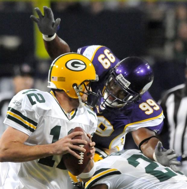Vikings linebacker Napoleon Harris leaps at Packers quarterback Aaron Rodgers as Minnesota beats Green Bay 28-27 on Nov. 9, 2008, at the Metrodome. (Pioneer Press file)
