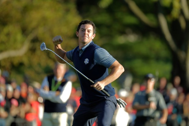 Europe's Rory McIlroy reacts after making his putt to win his match 3 & 2 during a four-balls match at the Ryder Cup golf tournament Friday, Sept. 30, 2016, at Hazeltine National Golf Club in Chaska, Minn. (AP Photo/Charlie Riedel)