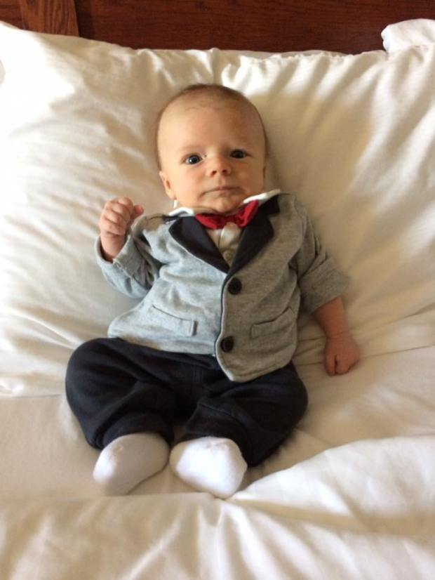 "Get him to the church on time! ... Reports GREAT-GRANDMA of Como Park: ""My 2-month-old great-grandson, Hank, is all dressed up to attend his first wedding. Just like most men when required to dress formally, he doesn't look too excited."""