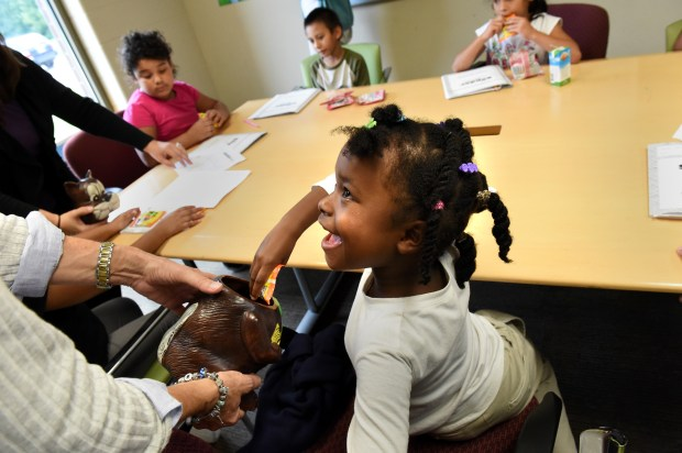 First grader Makailah Jackson picks a piece of candy at the end of an after-school reading lesson at the Al Lenzmeier West Side Boys & Girls Club in St. Paul on Thursday, Sept. 22, 2016. Boys and Girls Clubs of the Twin Cities is rolling out a pilot program to improve reading among children in first-through-third grade. (Pioneer Press: Jean Pieri)