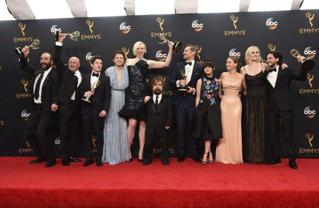 "Rory McCann, from left, Conleth Hill, Iwan Rheon, Hannah Murray, Gwendoline Christie, Peter Dinklage, Nikolaj Coster-Waldau, Maisie Williams, Emilia Clarke, Sophie Turner, and Kit Harington winners of the award for outstanding drama series for ""Game of Thrones"" pose in the press room at the 68th Primetime Emmy Awards on Sunday, Sept. 18, 2016, at the Microsoft Theater in Los Angeles. (Photo by Jordan Strauss/Invision/AP)"