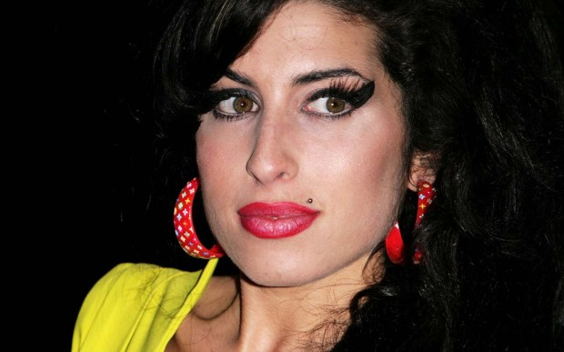 "The late English torch singer Amy Winehouse was born on this day in 1983. In 2011, the immense talent behind ""Rehab"" and ""Love is a Losing Game"" fell victim to ""death by misadventure,"" aka alcohol poisoning. She was 27. (Getty Images: Gareth Cattermole)"