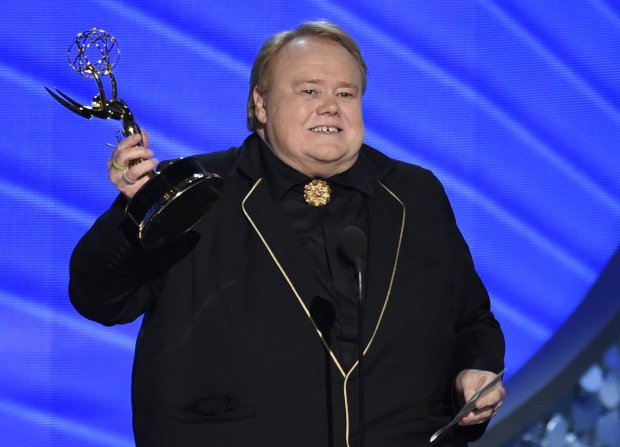 """Louis Anderson accepts the award for outstanding supporting actor in a comedy series for """"Baskets"""" at the 68th Primetime Emmy Awards on Sunday, Sept. 18, 2016, at the Microsoft Theater in Los Angeles. (Photo by Chris Pizzello/Invision/AP)"""