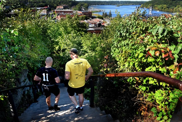 """A little piece of heaven,"" is what Brad Ayers calls the top of the Main Street stairs as he and his brother, Steve, left, make another trip down on Thursday, Sept. 8, 2016. For the past five months, they have traveled to Stillwater two or three times a week to train on the stairs. (Pioneer Press: Jean Pieri)"