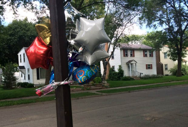 Balloons and candles were left on Galtier Street, near Orange Avenue, in St. Paul after Jason Mikulak was killed there on Thursday, Sept. 1, 2016. (Pioneer Press: Mara H. Gottfried)