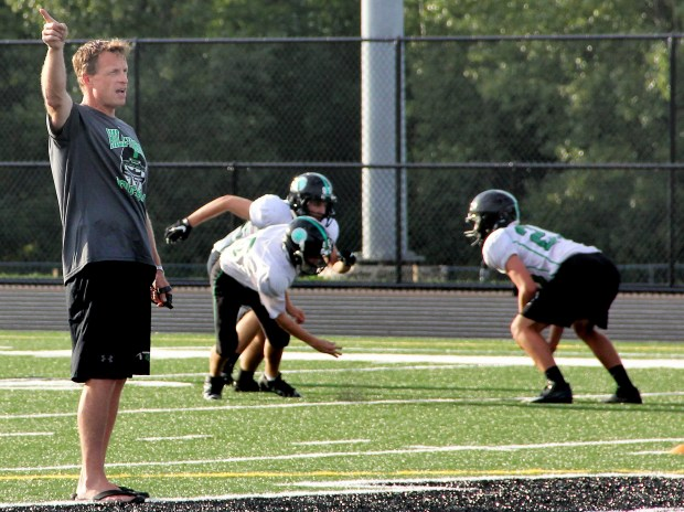 Hill-Murray football coach Pete Bercich, shown at left during practice at Hill-Murray in Maplewood on Wednesday, Sept. 7, 2016, is juggling being the Pioneers' head coach and still calling Minnesota Vikings' games for KFAN 100.3 FM. (Pioneer Press: Jace Frederick)