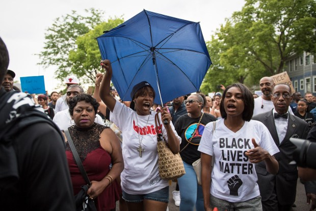Diamond Reynolds, center, the girlfriend of Philando Castile, and Valerie Castile, left, the mother of Philando, march during a demonstration in St. Paul, Minn. on Thursday July 07. (Washington Post: Jabin Botsford)
