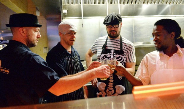 Chef Kendall Kail, from left, pastry chef Brian Titus, and line cooks Joshua Bau and James Anderson share a toast after serving a five-course dinner at Ward 6 on Payne Avenue in St. Paul, Tuesday, Sept. 13, 2016. (Pioneer Press: John Autey)