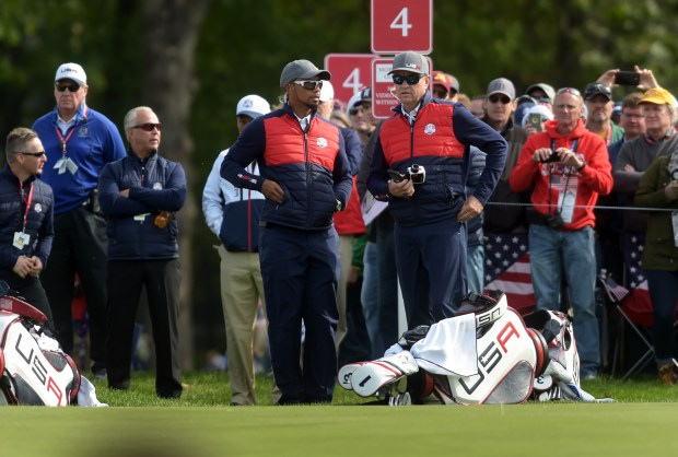 Tiger Woods and Davis Love III watch the U.S. team practice at the Ryder Cup at Hazeltine National Golf Club in Chaska, Minn., Tuesday, Sept. 27, 2016. (Pioneer Press: Scott Takushi)