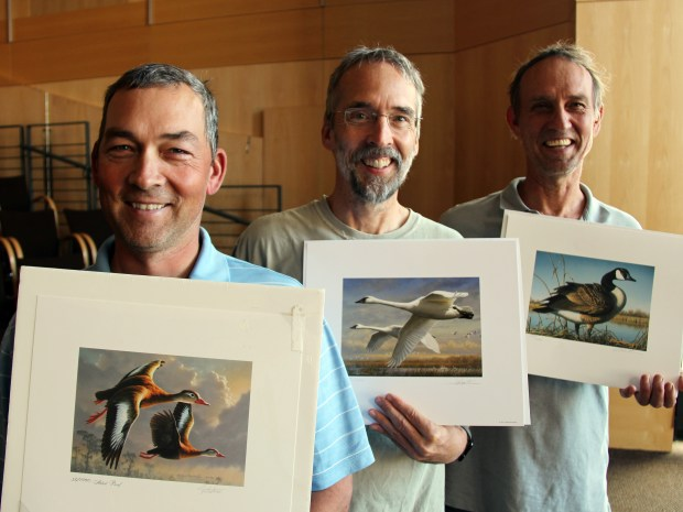 The Hautman brothers of Minnesota — left to right James (Chaska), Joseph (Plymouth) and Robert (Delano) had won 12 of the past 28 Federal Duck Stamp contests between them after James won the most recent contest in this 2016 photo. (Tom Weber/Minnesota Public Radio via AP)