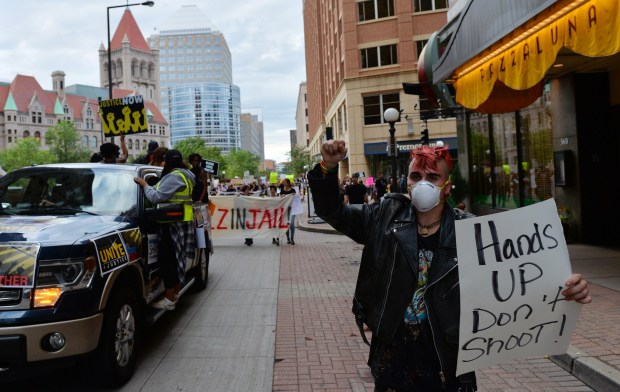 Protestors walk past Pazzaluna Restaurant as people demonstrate in downtown St. Paul on the two month anniversary of Philando Castile's death on Tuesday, Sept. 6, 2016. (Pioneer Press: John Autey)