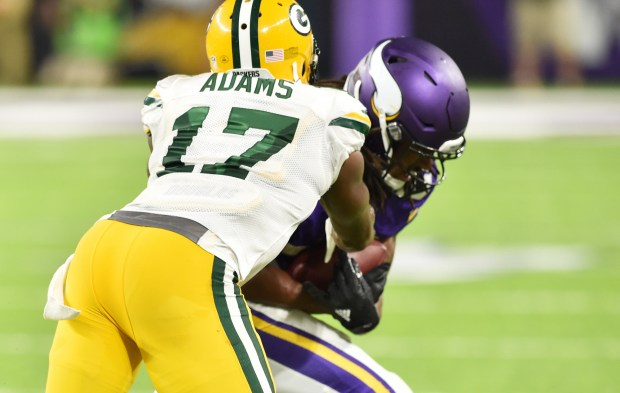 Minnesota Vikings cornerback Trae Waynes picks off the Green Bay Packers quarterback Aaron Rodgers pass in front of Green Bay Packers wide receiver Davante Adams to cinch the game in the fourth quarter at U.S. Bank Stadium in Minneapolis on Sunday, Sept. 18, 2016. (Pioneer Press: John Autey)