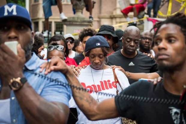 Diamond Reynolds, center, the girlfriend of Philando Castile, is comforted during a demonstration outside the governor's residence in St. Paul, Minn. on July 07. Castile was shot and killed after a traffic stop by police in Falcon Heights on July 6. A video shot by Diamond Reynolds of the shooting went viral. (Washington Post: Jabin Botsford)