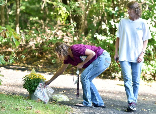 Locals Deborah Myer, left, and her twin sister Dianne Toulouse deliver a match-stick cross to the Wetterling house. The Stearns County Sheriff's Office announced on Saturday, Sept. 3, 2016, that the remains of Jacob Wetterling, who has been missing 27 years, had been found. Deborah feels a connection with Jacob because she learned she was pregnant with her child when Jacob was abducted. (Pioneer Press: John Autey)