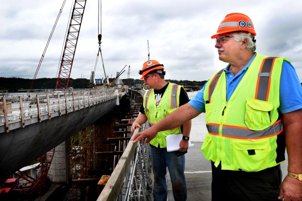 Terry Zoller, right, St. Croix Crossing construction director, checks out the progress with Josh Hebert, MnDOT bridge inspector in Stillwater on Friday, Sept. 16, 2016. He plans to retire the day the bridge opens in 2017.  (Pioneer Press: Jean Pieri)