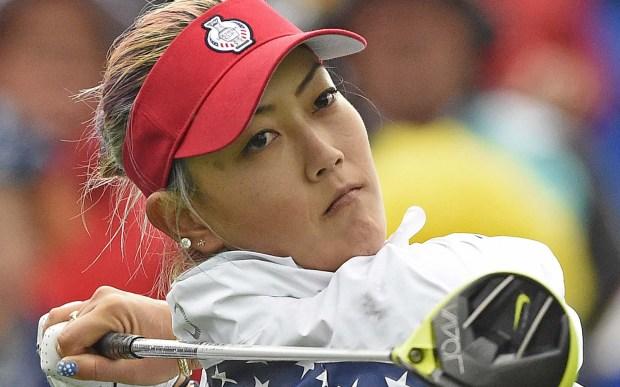 Stylin' golfer Michelle Wie is 27. (Associated Press: Jens Meyer)