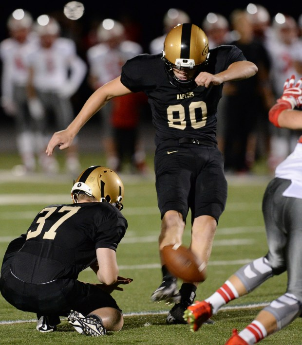 East Ridge kicker Grant Ryerse attempts a field goal against Lakeville North in the fourth quarter at East Ridge High School in Woodbury on Thursday, Sept. 1, 2016. (Pioneer Press: John Autey)