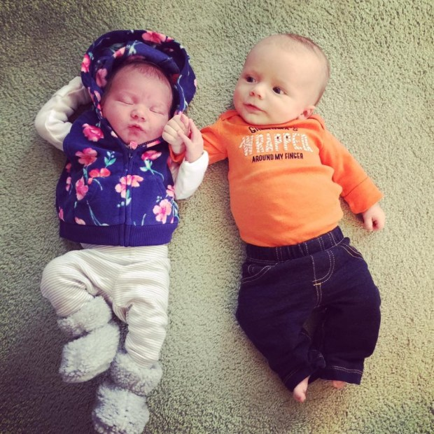"""The Permanent Family Record ... GREAT-GRANDMA of Como Park writes: """"The two newest great-grandchildren, cousins, meet for the first time. Born eight weeks apart, Hank looks at 7-day-old Logan as if hoping they will be best friends."""""""
