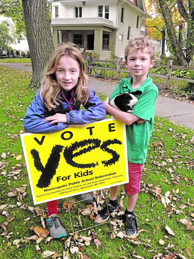 Fifth-grader Samantha Eberly, her third-grade brother, Mason, and their guinea pig Ginger campaign for strong public schools. (Courtesy of Donna Erickson)