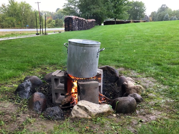 Oct. 6, 2016 of the booya pot is set on top of three cinder blocks and a grill grate. (Pioneer Press: Jessica Fleming)