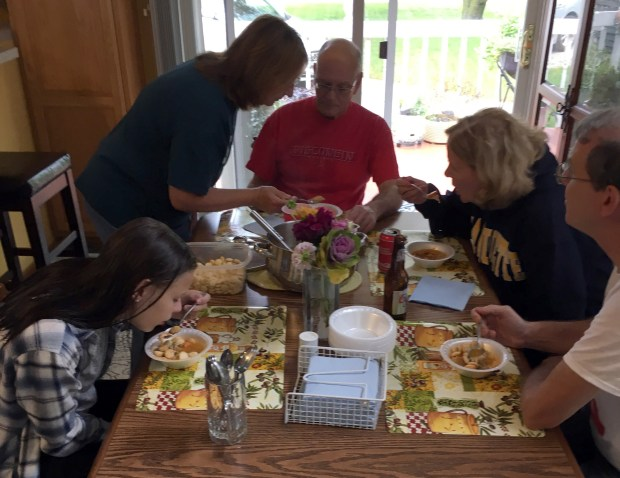 Family enjoy the day's first batch of booya. (Pioneer Press: Jess Fleming)