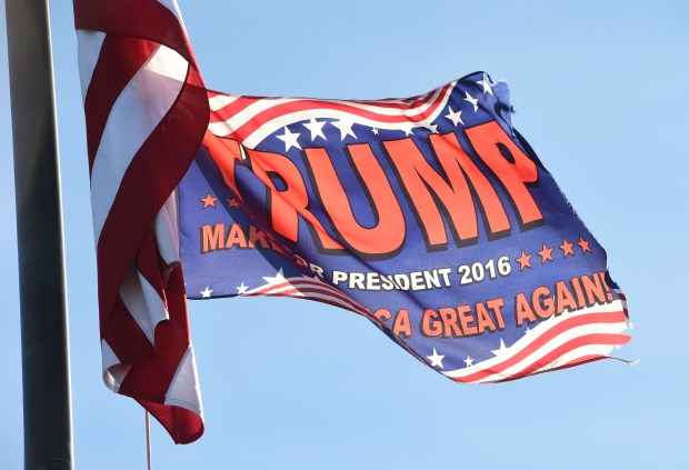 A pro-Donald Trump flag flies just below the U.S. flag on the pole in front of Gorman's Restaurant in Lake Elmo, Monday, Oct. 24, 2016.  (Pioneer Press: Scott Takushi)