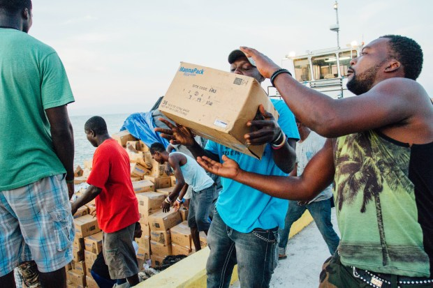 Meals packed by volunteers with Twin Cities-based Feed My Starving Children have been feeding Haitians in the wake of Hurricane Matthew. In Oct. 2016, the Texas-based mission group Mission of Hope moved thousands of boxes of MannaPack rice from storehouses in Port au Prince to distribute in the hard-hit southwest part of the island. (Photo Courtesy Mission of Hope)