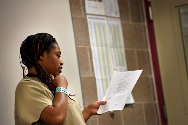 "Najkiia Williams, 31, of St. Paul reads her poem, ""Mentally Scared"" in a creative writing class at Washington County Jail in Stillwater on Wednesday, Sept. 28, 2016. (Pioneer Press: Jean Pieri)"