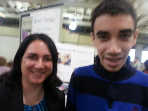Justin Anderson, 15, and his mom Rachel of Minnetonka launched their company, Sigma's Bookshelf, at the Twin Cities Book Festival Saturday, Oct. 15, 2016, at the Minnesota State Fairgrounds. Rachel Anderson thinks it is the first company to empower teen authors to get their work published. (Pioneer Press: Mary Ann Grossmann)