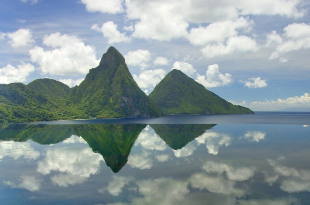 The Piton Mountains are reflected in the water on Saint Lucia. (Courtesy Saint Lucia Department of Tourism)