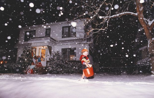 Zachary Cizek, 3, trudges through the snow as he goes trick-or-treating in the 1800 block of Goodrich Avenue in St. Paul on Oct. 31, 1991.