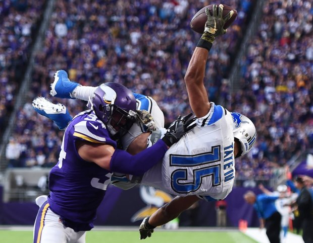 Golden Tate of the Detroit Lions leaps into the end zone over Andrew Sendejo of the Minnesota Vikings during overtime on Nov. 6, 2016 at U.S. Bank Stadium. The Lions won 22-16. (Stacy Revere / Getty Images)