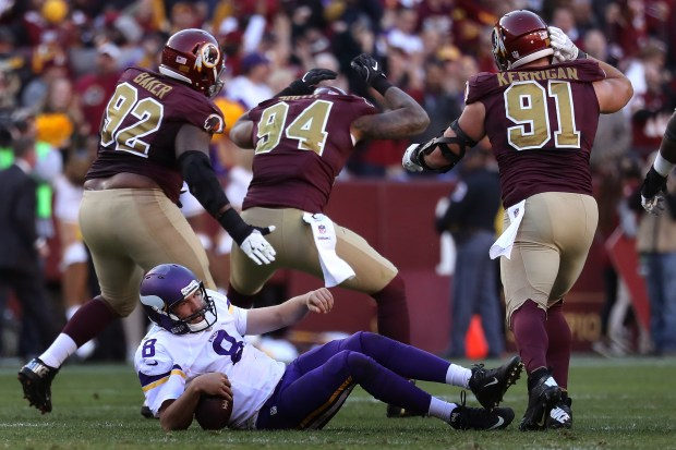 Vikings quarterback Sam Bradford is sacked by outside linebacker Preston Smith of the Washington Redskins in the fourth quarter at FedExField on November 13, 2016 in Landover, Maryland. (Photo by Rob Carr/Getty Images)
