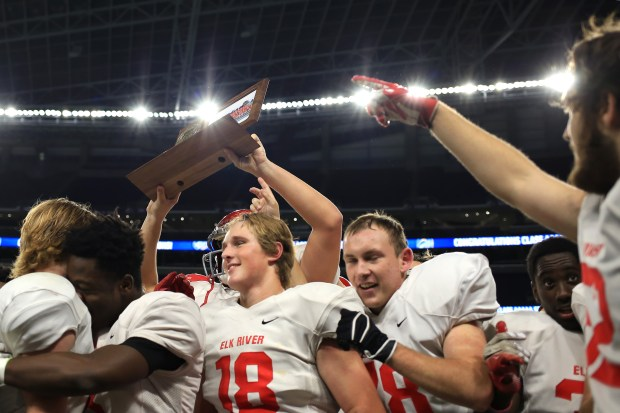 The Elk River Elks football team celebrates after they defeated the Spring Lake Park Panthers in the 5A championship game at U.S. Bank Stadium on Saturday, Nov. 26, 2016. (Pioneer Press: Liam James Doyle)