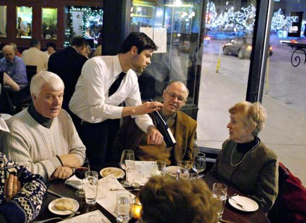 A bottle of wine is served as part of dinner at Meritage in St. Paul on Friday, January 18, 2008. (Ben Garvin, Pioneer Press)