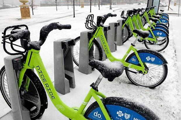 These Nice Ride bikes at a rack near Shepard Road did not get much use Thursday as snow and sleet hit the Twin Cities on April 18, 2013. (Pioneer Press: Scott Takushi)