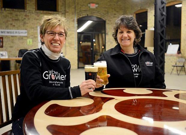 Urban Growler owners Jill Pavlak, left, and Deb Loch are entrepreneurs and newlyweds. They opened their St. Paul brewery and taproom in summer 2014. (Pioneer Press: Chris Polydoroff)