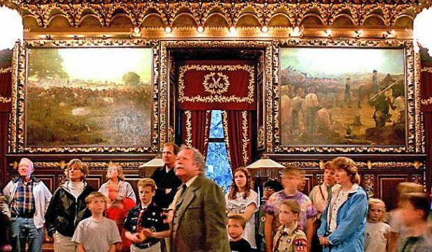 "A tour group passes through the Governor's Reception Room to view paintings from the Civil War era. At left is ""Battle of Gettysburg, July 1-3, 1863"" by Rufus Zogbaum. At right is ""Fourth Minnesota Regiment Entering Vicksburg, July 4, 1863"" by Francis D. Millet. (Pioneer Press file: Chris Polydoroff)"