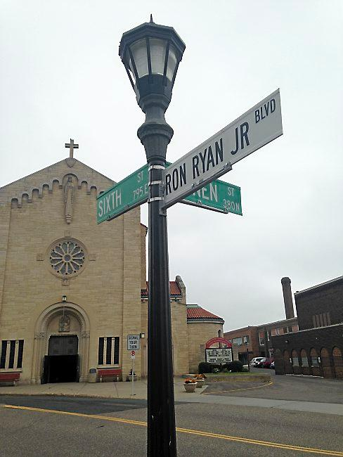 A stretch of Sixth Street in St. Paul was dedicated for St. Paul police officer Ron Ryan Jr., who was fatally shot in the parking lot of Sacred Heart Church in 1994. The sign is pictured Aug. 17, 2014. (Pioneer Press: Mara Gottfried)