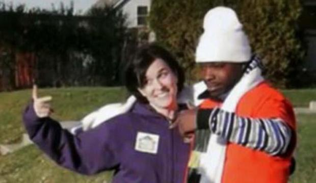 In this image made from a video released by Neighborhoods Organizing for Change, Minneapolis Mayor Betsy Hodges and Neighborhoods Organizing for Change employee Navell Gordon gesture while they knock on doors to get out the vote in North Minneapolis on Saturday, Nov. 1, 2014. (AP Photo/Neighborhoods Organizing for Change)