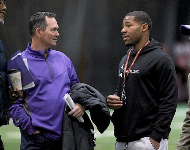 Former University of Minnesota running back David Cobb, right, talks with Minnesota Vikings head coach Mike Zimmer, left, during Minnesota pro day in Minneapolis, Monday, March 2, 2015. (AP Photo/Ann Heisenfelt)