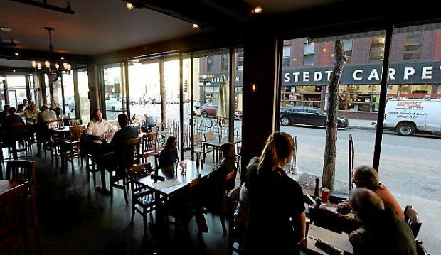 There is plenty of window seating at the Ox Cart Ale House in St. Paul's Lowertown on Wednesday, September 30, 2015. On warmer days the windows open like patio doors. (Pioneer Press: John Autey)