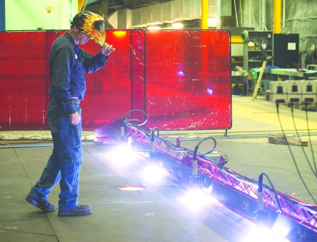 Automated plasma cutters work their way through a 12-ton steel plate.